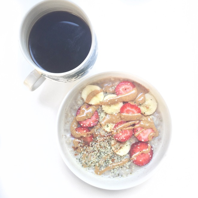 Breakfast: chia seed oatmeal with bananas, strawberries, hemp seeds, and almond butter.