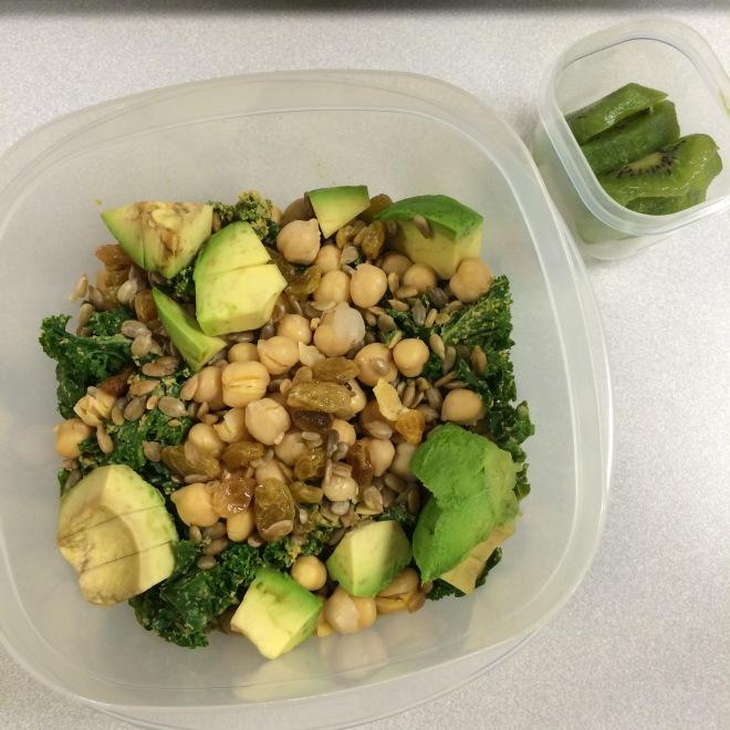 kale salad with chickpeas, sunflower seeds, golden raisins, and avocado + a kiwi